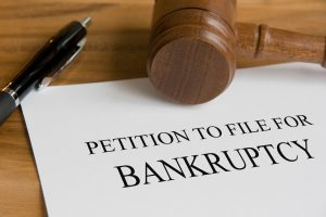 return to file for bankruptcy