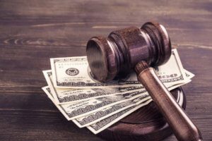 Gavel and some dollars banknotes