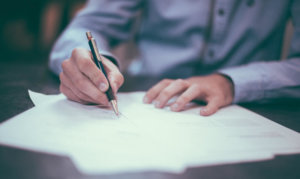 person signing a restraining order