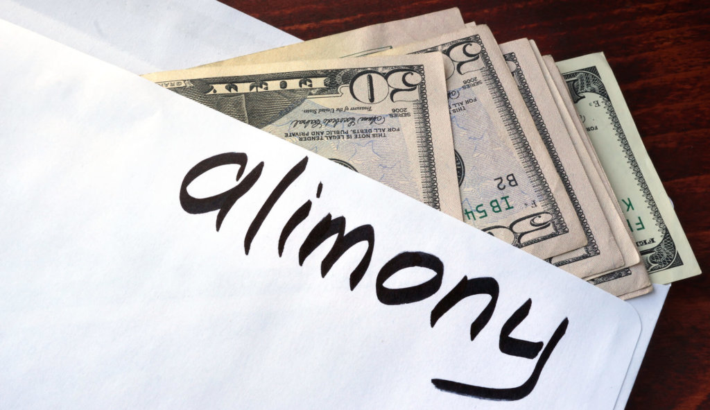 Alimony written on an envelope with dollars