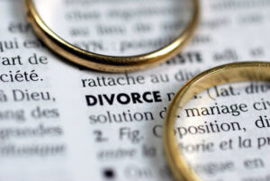 wedding rings laying on divorce definition