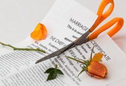 Marriage papers being cut by scissors